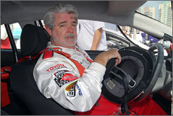 Raring to go: Star Wars creator George Lucas will take the wheel for the Toyota Pro/Celebrity Race next week. Next up: the fourth Indiana Jones movie.