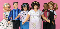 In stores soon: Hairspray's Amber von Tussel (played by Brittany Snow), left, Link Larkin (Zac Efron),Tracy Turnblad (Nicole Blonsky), Mom Edna (John Travolta), Seaweed J. Stubbs (Elijah Kelley) and Penny Pingleton (Amanda Bynes).