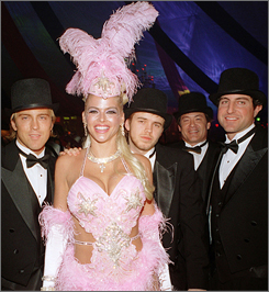Anna Nicole Smith  attends a Halloween party at the Playboy mansion with Larry Birkhead, left, Daniel Smith and Howard K. Stern, far right, on Oct. 30, 2004.
