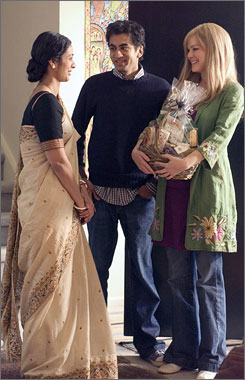 Praiseworthy: Kal Penn plays the son of Indian immigrants in The Namesake, with Tabu, left, and Jacinda Barrett. The film has earned nearly $7 million.