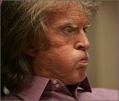 Facing the storm: Don Imus waits toappear on Al Sharpton's radio show.