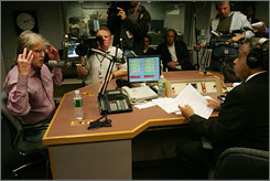 Making amends: Radio host Don Imus, left, apologizes for his remark again while talking to the Rev. Al Sharpton on Sharpton's radio show Monday.