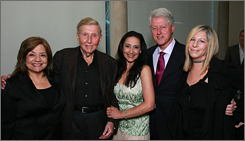 The National Breast Cancer Coalition's Fran Visco, left, gets an assist from Viacom boss Sumner Redstone and wife Paula, President Bill Clinton and Barbra Streisand. Breast cancer killed the former president's mother in 1994.