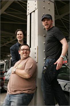 In on the action: Director Edgar Wright, left, with British actors Nick Frost and Simon Pegg, is out with Hot Fuzz, already a hit in the U.K. The film opens in the USA on Friday.