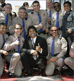 New Hollywood Walk of Fame entrant Erik Estrada, center,  calls for a little back-up from the California Highway Patrol.