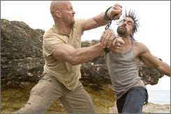 Fight to the death: Steve Austin, left, and Manu Bennett are Death Row prisoners trapped in a bizarre reality competition.