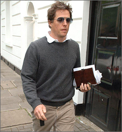 Days after making headlines with his baked-bean-paparazzo recipe, Hugh Grant has accepted libel damages from a British newspaper publisher over stories about his past two  girlfriends.