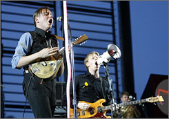 Burning brightly: Singer Win Butler, left, leads the Arcade Fire during its set Saturday at the Coachella Music Festival. The band was one of 115 acts that performed. More than 180,000 fans came to the show in Indio, Calif., jamming traffic and filling hotels.