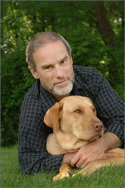 Best friends: John Grogan, with Gracie, has two Marley books out for kids.