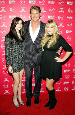 David Hasselhoff and his daughters Taylor-Ann Hasselhoff, 16, left, and Hayley Hasselhoff, 14, attend a party earlier this year. According to several TV shows, Taylor-Ann recorded an inebriated Hasselhoff on video and pleaded with him to stop drinking.
