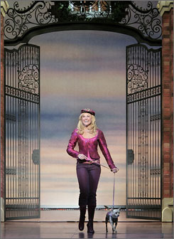 Getting the last yap: Elle Woods (Laura Bell Bundy) and Bruiser.