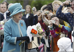 Queen Elizabeth II greets well-wishers as she tours the Jamestown Settlement in Williamsburg, Va.