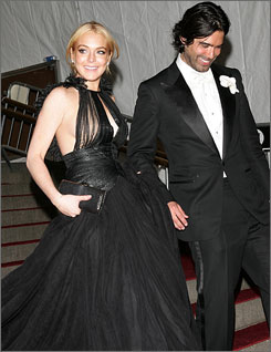 Lindsay Lohan steps out in a black Bally gown with designer Brian Atwood.