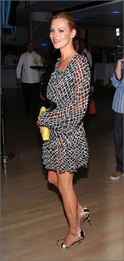 At Barneys New York: British model Kate Moss is in the USA to launch her new clothing line for fashion chain Topshop.