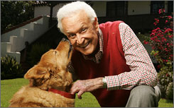 Animal advocate: Bob Barker gets some love from rescue dog Jessie in the backyard of his historic home in Hollywood.