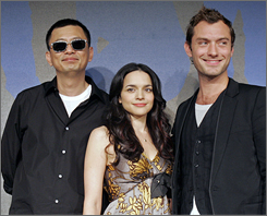 Chinese director Wong Kar-wai, left, American singer Norah Jones and British actor Jude Law appear together at a press conference for the film My Blueberry Nights  at the Cannes Film Festival on Wednesday.