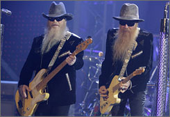 ZZ Top's Dusty Hill, left, with Billy Gibbons, has a growth in his inner ear that requires treatment, forcing the band to cancel its European tour.