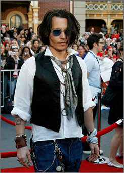 Pirates of the Caribbean star Johnny Depp sported his signature bohemian style to the premiere.