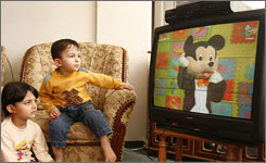 Palestinian children watch a Mickey Mouse look-alike, who urges children to support armed resistance against Israel, on Al-Aqsa TV in Gaza on May 13. Hamas' television station defied the Hamas-led Palestinian government on Friday by airing another weekly episode of the show.