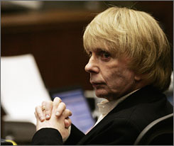 Phil Spector listens to his former driver, Adriano De Souza, during cross examination at Los Angeles Superior Court on Monday.