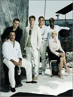 Ocean's Thirteen the rap of Cannes: Cast members Andy Garcia, left, Matt Damon, Brad Pitt, George Clooney, Don Cheadle and Ellen Barkin hold court at the Hotel Eden Rock in Cannes, France.