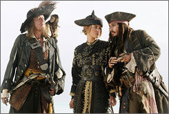 Geoffrey Rush, left, Keira Knightley and Johnny Depp in a scene from Pirates Of The Caribbean: At World's End