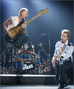 Sting, left, goes airborne as he and Police bandmates Stewart Copeland (center) and Andy Summers launch their reunion tour in Vancouver.