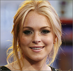 Lindsay Lohan was arrested and treated for minor injuries after her car crash early Saturday.