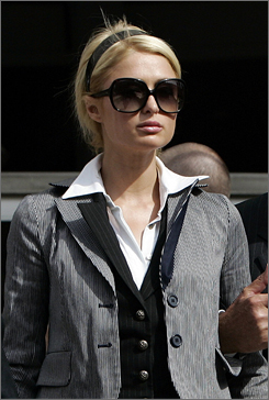 Paris Hilton leaves the Los Angeles Municipal Court Metropolitan branch with her father Rick, May 4.
