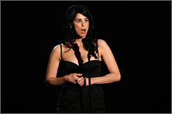 Black ensemble, blue language: Awards host Sarah Silverman came out firing, keeping the network censors busy. Among her targets: Paris Hilton, Lindsay Lohan and Alec Baldwin.