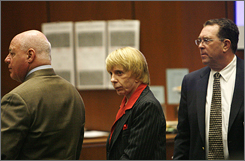 Music producer Phil Spector, center, stands with defense attorneys Bruce Cutler, left, and Christopher Plourd during the morning session of the Lana Clarkson murder trial at Los Angeles Superior Court .
