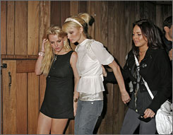 A night on the town: Britney Spears, left, Paris Hilton and Lindsay Lohan out at a party at the Beverly Hills Hotel in November. The three starlets are leading a pack of twentysomething celebrities in the news for their troubles with the law and addictions.