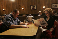 You don't want the duck: Tony (James Gandolfini) and Carmela (Edie Falco) get the check Sunday night.