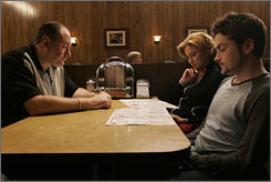 The last supper?: James Gandolfini, left, Edie Falco and Robert Iler wait to order food in a diner in the Mob drama's final scene.