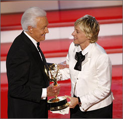 Bob Barker accepts the award for outstanding game show host for his work on The Price Is Right  from Ellen DeGeneres at the 34th Annual Daytime Emmy Awards in L.A. on Friday.