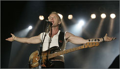 Somebody called The Police: Sting greets Bonnaroo fans Saturday night. The band's stop on its reunion tour was a huge hit.