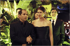 Adding to USA's success: Peter Jacobson and Debra Messing become unraveled in the popular miniseries Starter Wife. At right is Joe Mantegna.