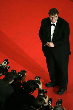 Lights, camera, reaction: Michael Moore arrives for a screening of Sicko at the Cannes Film Festival last month. The film, which drew raves, suggests health care is better in Cuba than it is for some here.