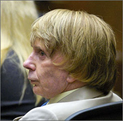 Phil Spector listens to testimony in the courtroom during his murder trial in Los Angeles on Tuesday.