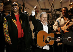 """Prize winner: Paul Simon, right, performs with Stevie Wonder at the tribute, which included some """"unusually moving"""" renditions."""