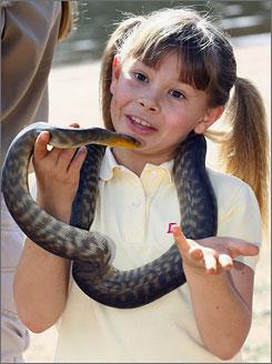 Bindi Irwin, daughter of Crocodile Hunter Steve Irwin, tames a snake while promoting her upcoming ABC children's show Bindi The Jungle Girl.