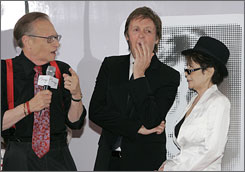 Just kidding: Paul McCartney jokingly yawns while being interviewed by Larry King Tuesday night as Yoko Ono looks on.
