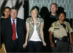 Breathing free air: Hilton leaves jail with her lawyer, Richard Hutton, early Tuesday in Lynwood, Calif.