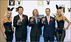 Macao Studio City CEOs Ambrose Cheung, second from left, and David Friedman, second from right, toast with Playboy CEO Christie Hefner, center, to celebrate a Playboy Mansion coming to Macau.