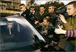 Nicole Kidman leaves her Sydney home while photographers swarm her car on  June 23, 2006.