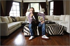 "A ""boutique hotel"" feel: Christian Audigier, designer of the Ed Hardy clothing line, is coolly casual in the nine-bedroom, nine-bath home he shares with his wife and three children."