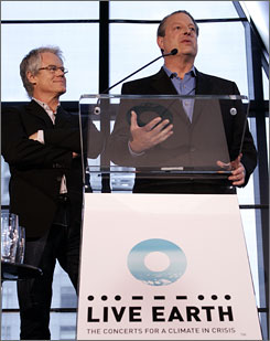 SOS founder Kevin Wall, left, and Al Gore detail plans for the upcoming Live Earth concerts. 