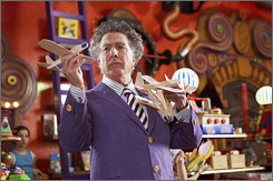 Like a kid in a toy store: Dustin Hoffman plays the centuries-old proprietor.