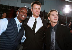"Megatron stars: Tyrese Gibson, left, Josh Duhamel and Shia LaBeouf hit the Transformers premiere in L.A. But LaBeouf favored the Smurfs as a kid: ""Papa Smurf was the man!"""