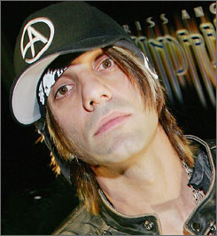 "The estranged wife of illusionist Criss Angel says he deserted her as he became more famous  and hasn't given her ""a cent"" of his millions."